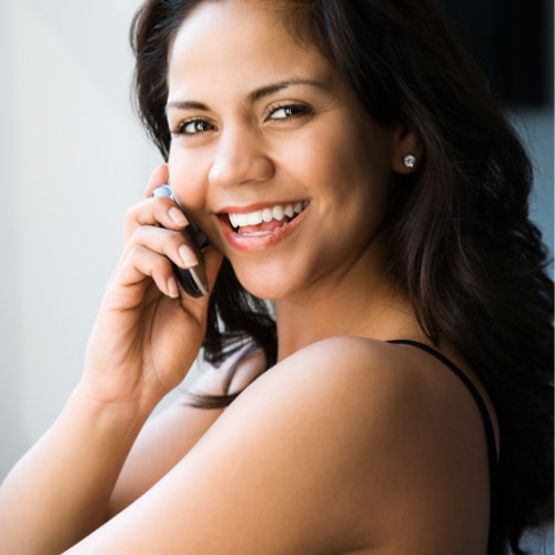 latino woman on a cell phone