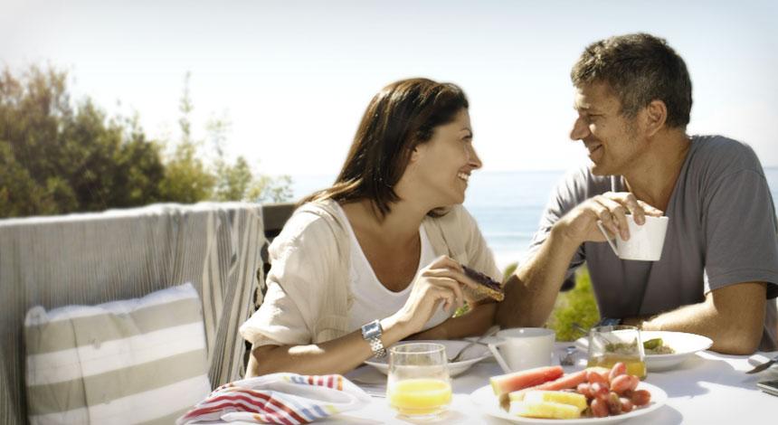 man and wife enjoying breakfast